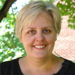 Headshot of Marilyn Ghezzi with tree in background